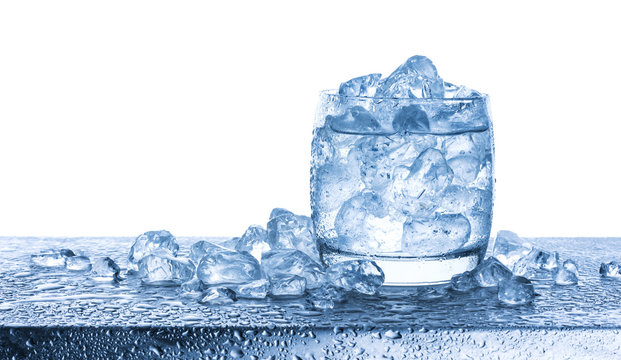 Water with crushed ice cubes in glass on white background