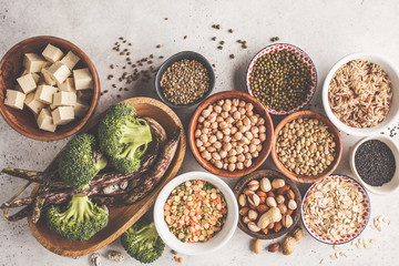 Vegan protein source. Tofu, beans, chickpeas, nuts and seeds on a white background, top view, copy space.