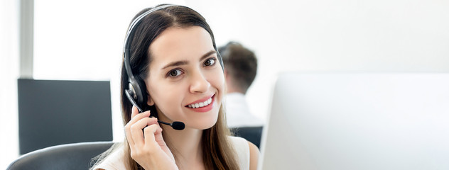 Smiling beautiful friendly woman in call center banner background