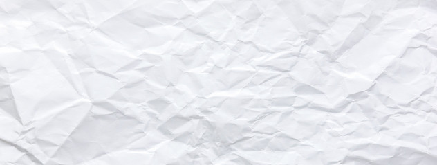 Fototapete - Ragged crumpled white paper texture banner background