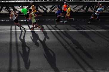 Runners cross the river Danube over the Chain Bridge during the 33. Spar Budapest Marathon in Budapest