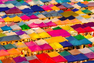 Multiple colour aerial view night flea market, cityscape downtown