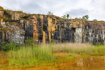 Old abandoned open pit mining with a pond