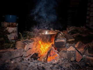 vacationers are roasted on the fire in a pot tasty meal