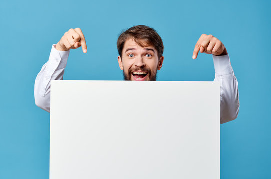happy man shows his fingers on a white sheet of paper