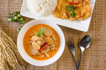 Delicious red curry chicken bamboo shoots with omelet and cooked rice,Thai food style