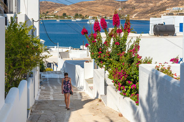 Pretty woman climbing stairs in Greece. Summer vacations. Serifos island.Greece