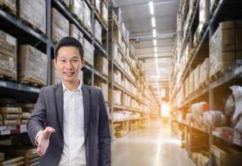 Business man handshake success business with warehouse image blur background