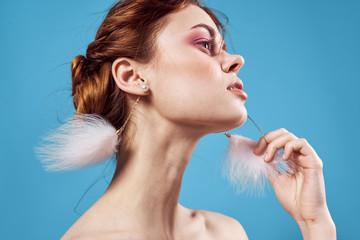 beautiful woman in light earrings gentle makeup