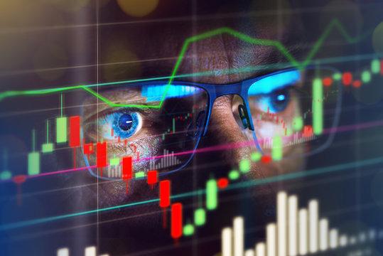 Close up of stock market trader looking at graph