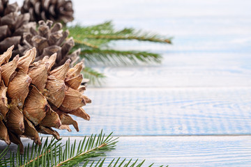 Christmas festive background - gifts and fir cones and on a blue background.