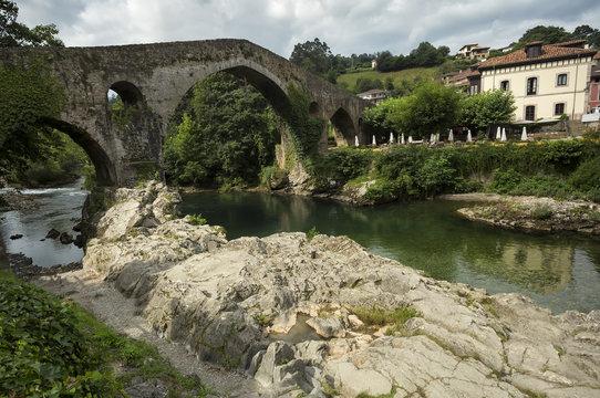 Cangas de Onis roman bridge on Sella river in Asturias of Spain.