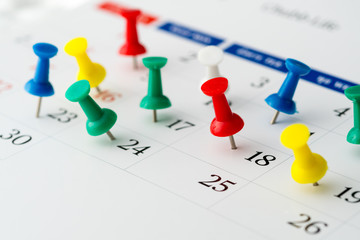 Push pins on calendar. Idea concept of to do planning.