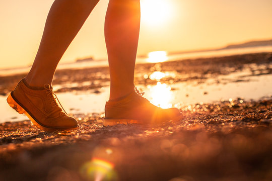 Women in the yellow shoes with sunset sea background