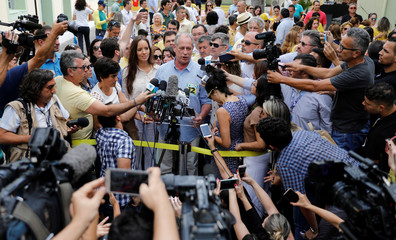 Presidential candidate Ciro Gomes of the Democratic Labour party (PDT), talks with journalists after casting his vote in Fortaleza