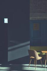 Chair in an empty black dark room