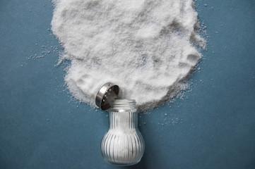 A pile of salt from salt shaker, concept excessive salt intake