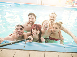 friends at the pool having fun and taking a selfie