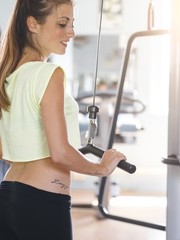 attractive young female exercising in a gym