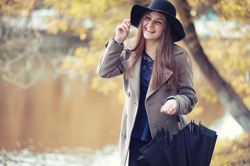 Young girl in a coat in autumn  park