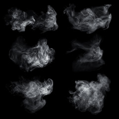 Fog or smoke set isolated on black background. White cloudiness, mist or smog background.