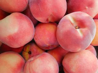 fresh testy peaches closeup background