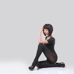 Beautiful woman posing in hosiery and heels