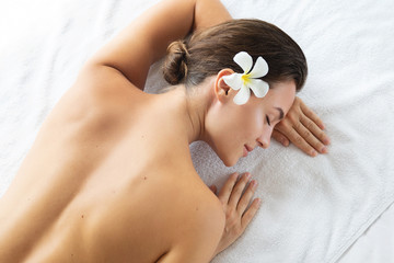 Woman is lying and relaxing after massage session