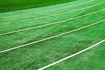 Running track with green artificial grass