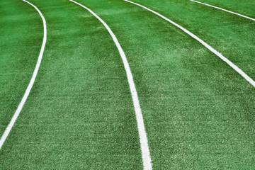 Empty running track with an artificial turf