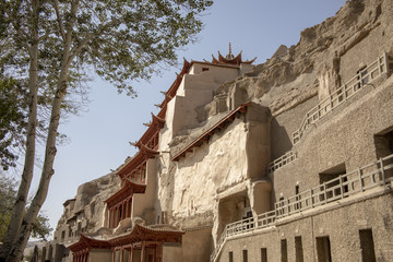 Pagoda with boardwalks outside Mogao Grottoes, Dunhuang, Ganzu, China
