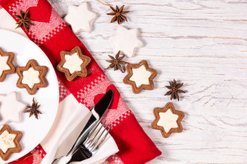 Holiday concept with napkin, cutlery, cookies and spices