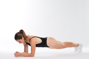Beautiful sports woman in black body