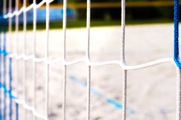 blue-white beach volleyball net close-up. Background