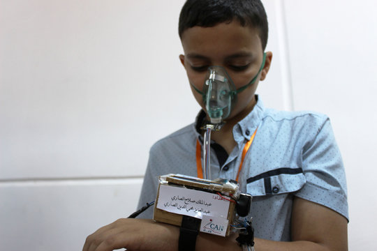 """A student wears a student made """"smart watch"""", which measures the temperature and blood pressure of its users, in the city of Zliten"""
