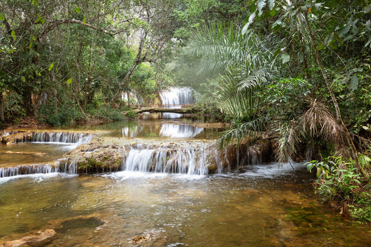picturesque waterfalls in the jungle.