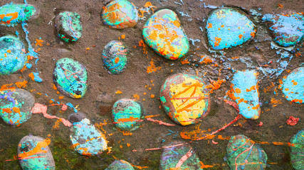 Multicolored stones and creative fish made of stone. The painting is painted in different colors in texture style. Grunge background