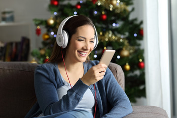 Girl listening to music in christmas at home