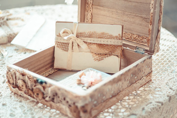 Delicate composition with letters in a box decorated in rustic s