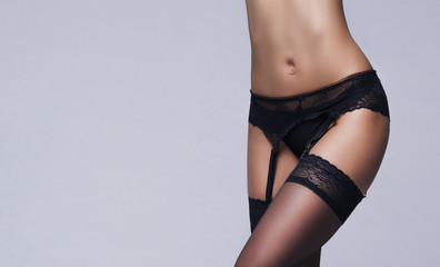 Female body in underwear. Young brunette woman in lingerie.