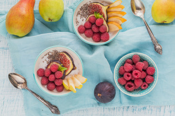 Smoothie bowl with fresh fruits, chia seeds, raspberry and fig