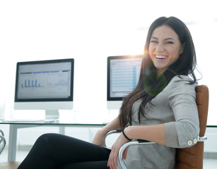 business woman working with financial charts on computer