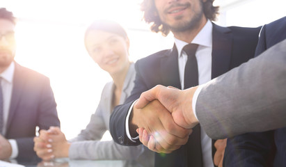 background image of handshake of business partners