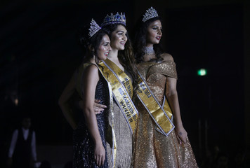 Winner of Miss Transqueen India 2018 beauty pageant Vina Sendre (C) first runner up Sanya Sood (L) and second runner up Nimitha Ammu pose for photographs in Mumbai