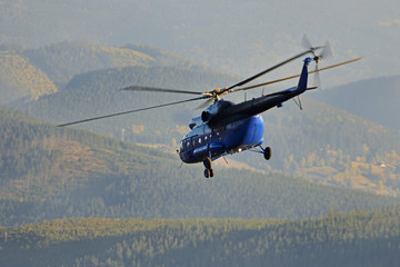 MI-8 helicopter in the mountains.