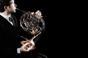 Keuken foto achterwand Muziek French horn player. Hornist playing brass orchestra music instrument