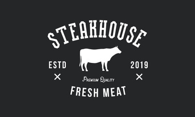 Steak House logo. Vintage design. Cow silhouette. Grill Restaurant emblem. Vector