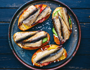homemade sprat sandwiches with vegetables and mayonnaise top view