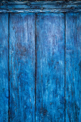 Bright blue painted old board, boho abstract background