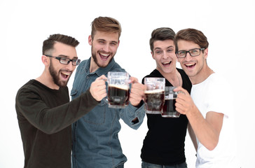 four happy young men, clinking glasses of bee